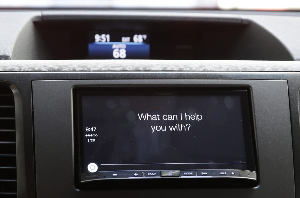 The new Apple CarPlay, featuring Siri voice control, asks a driver a question during a demonstration in San Francisco. (AP Photo/Eric Risberg)