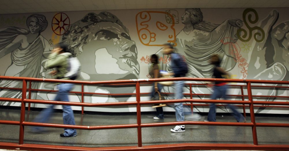 English High School students walk past a mural at the school in Boston's Jamaica Plain neighborhood. (AP)