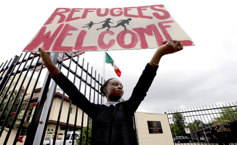 Zelda holds up a sign as she joins demonstrators outside the Mexican Consulate Friday, July 18, 2014, in Houston. Prospects for action on the U.S.-Mexico border crisis faded Thursday as lawmakers traded accusations rather than solutions, raising chances that Congress will go into its summer recess without doing anything about the tens of thousands of migrant children streaming into South Texas. (AP)