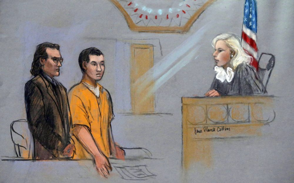 In this courtroom sketch, defendant Azamat Tazhayakov, center, a college friend of Boston Marathon bombing suspect Dzhokhar Tsarnaev, stands for arraignment with his attorney, Nicholas Wooldridge, left, before Federal Magistrate Marianne Bowler, Friday, Sept. 13, 2013 at the Moakley Federal Courthouse in Boston. Tazhayakov pleaded not guilty to hindering the investigation into the attack. (AP)