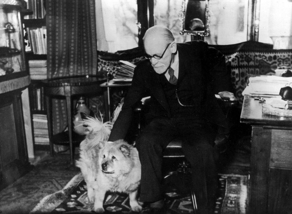 """Austrian psychoanalyst Prof. Sigmund Freud and his dog """"Jofi"""" in his office in Vienna, Austria, in 1937. (AP)"""