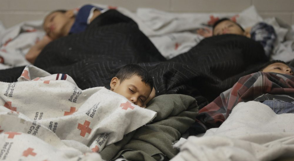 "Carol Rose and Adriana Lafaille: ""With Governor [Deval] Patrick clearing the way for hundreds of child migrants to be brought to shelters in the Commonwealth, it is essential that the federal government act to protect their right to legal representation."" Pictured: June 18, 2014: Child detainees sleep in a holding cell at a U.S. Customs and Border Protection processing facility in Brownsville,Texas. For years, children from Central America traveling alone, and immigrants who prove they have a credible fear of returning home, have been entitled to a hearing before an immigration judge. (Eric Gay /AP)"