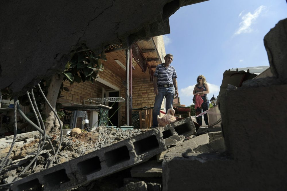 "Barry Shrage: ""No nation anywhere can be expected to tolerate assaults on its citizens, and Israel has every right to defend itself vigorously and decisively."" Yerechmiel Steinberg looks at the damages of his home after a rocket fired by Palestinian militants in Gaza landed in the southern town of Sderot, Thursday, July 3, 2014. Israeli military carried out airstrikes on the Gaza Strip after Palestinian militants fired rockets into Israel early Thursday. The Israeli military said the air force struck 15 ""terror sites"" in Gaza. ""The targets included weapons manufacturing sites as well as training facilities,"" a military spokesman said. (Tsafrir Abayov/AP)"