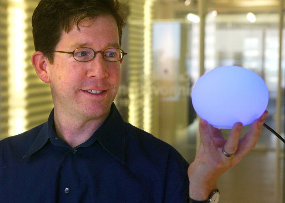 David Rose displays an Ambient Orb, which changes colors to reflect trends in information on a particular subject which is transmitted via the Internet. (Robert Spencer/AP)