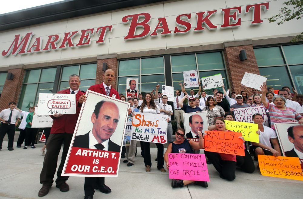 Market Basket employees face an ultimatum to return to work today without fear of penalty. Market Basket employees are pictured here on July 25 in Haverhill in a show of support for Arthur T. Demoulas, the former chief executive of the supermarket chain.(AP)