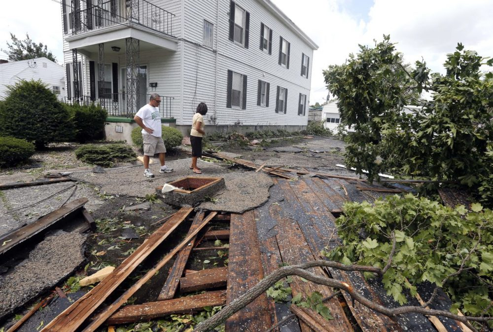 Christine Molle and her husband, Wayne, survey the damage to her mother's house. (Elise Amendola/AP)