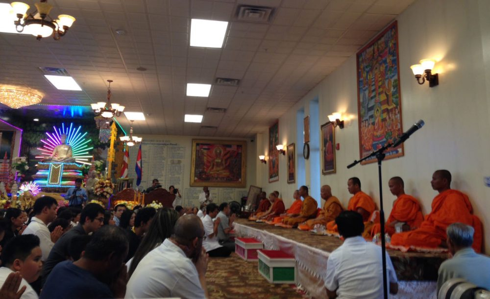 Monks lead gatherers in prayer at the Glory Buddhist Temple in Lowell. (Kassandra Sundt/WBUR)