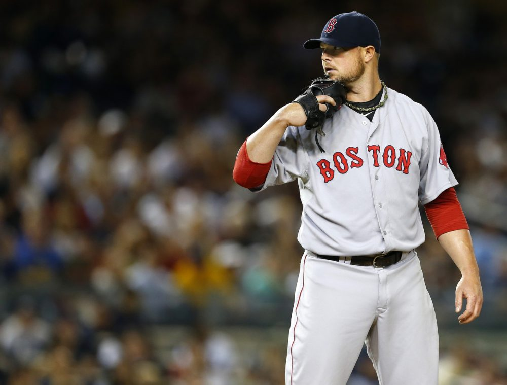 Red Sox ace Jon Lester was dealt to the Oakland A's at the trade deadline. Fellow pitchers John Lackey and Andrew Miller, as well as shortstop Stephen Drew, were also traded away. (Rich Schultz/Getty Images)