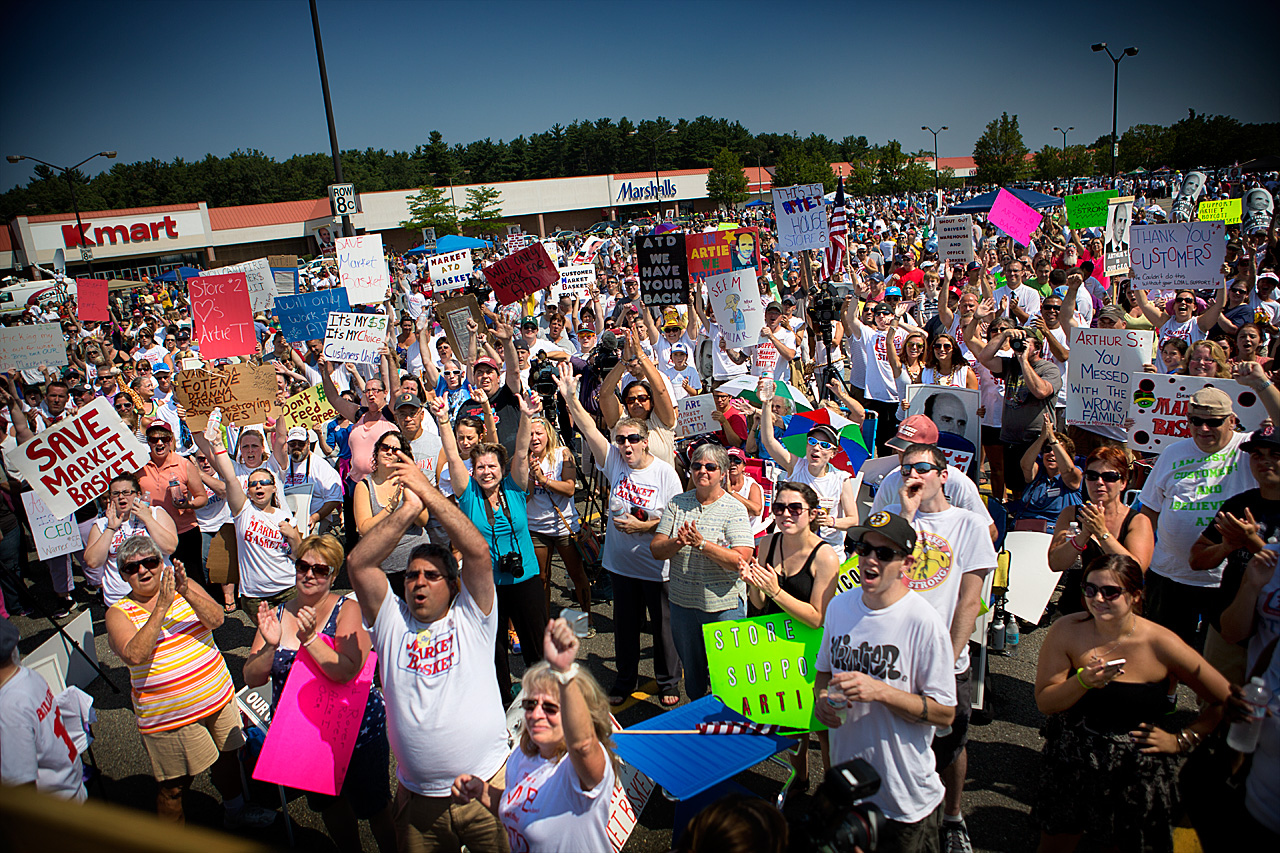 Though not mentioned by name, protesting Market Basket workers, like those seen here last month in Tewksbury, likely affected the state jobs figures.  (Jesse Costa/WBUR)