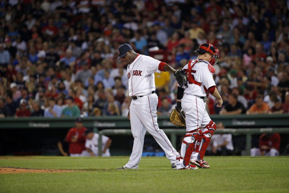 Red Sox starting pitcher Rubby De La Rosa pats Boston Red Sox catcher Christian Vazquez. (AP/Elise Amendola)