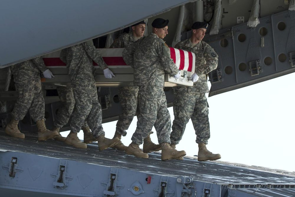 An Army carry team transfers the remains of Army Maj. Gen. Harold Greene at Dover Air Force Base in Delaware Thursday. (Evan Vucci/AP)
