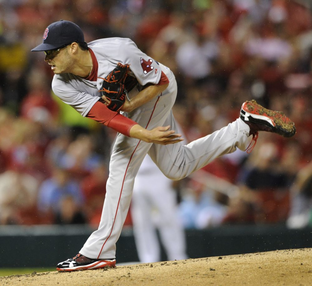 Red Sox's starting pitcher Joe Kelly (56) throws against the St. Louis Cardinal. (AP Photo/Bill Boyce)