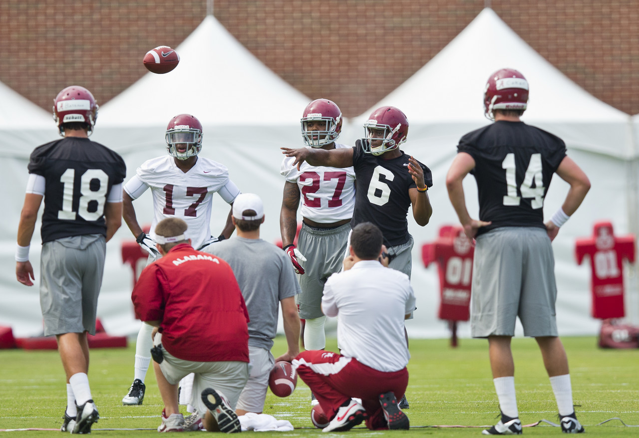 Cooper Bateman (18), Blake Sims (6) or Jake Coker (14) could all start at QB for the Crimson Tide. (Brynn Anderson/AP)