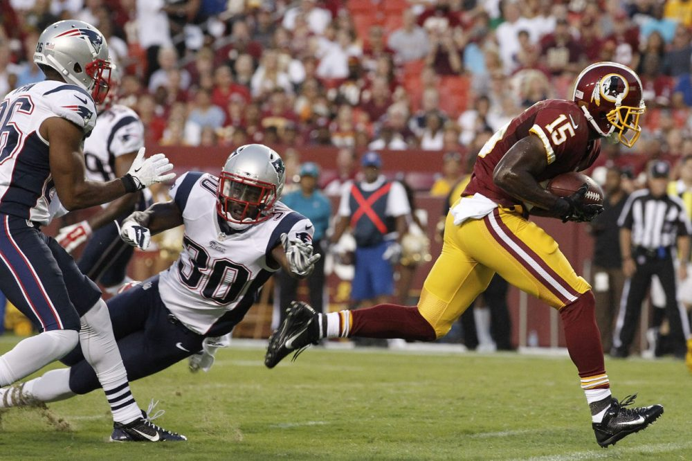 Redskins wide receiver Aldrick Robinson breaks free from New England Patriots strong safety Duron Harmon (30) and scores a touchdown. (AP/Alex Brandon)