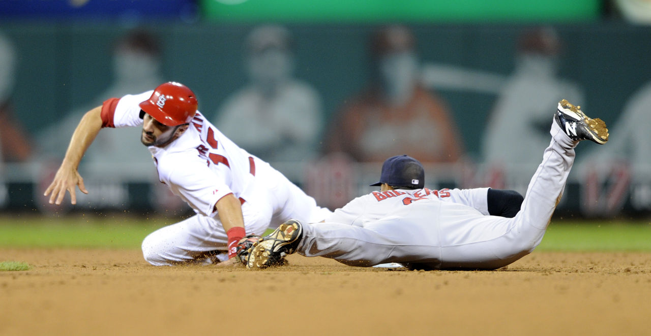 St. Louis Cardinals' Matt Carpenter, left, is tagged out stealing by Boston Red Sox's Xander Bogaerts. (AP/Bill Boyce)