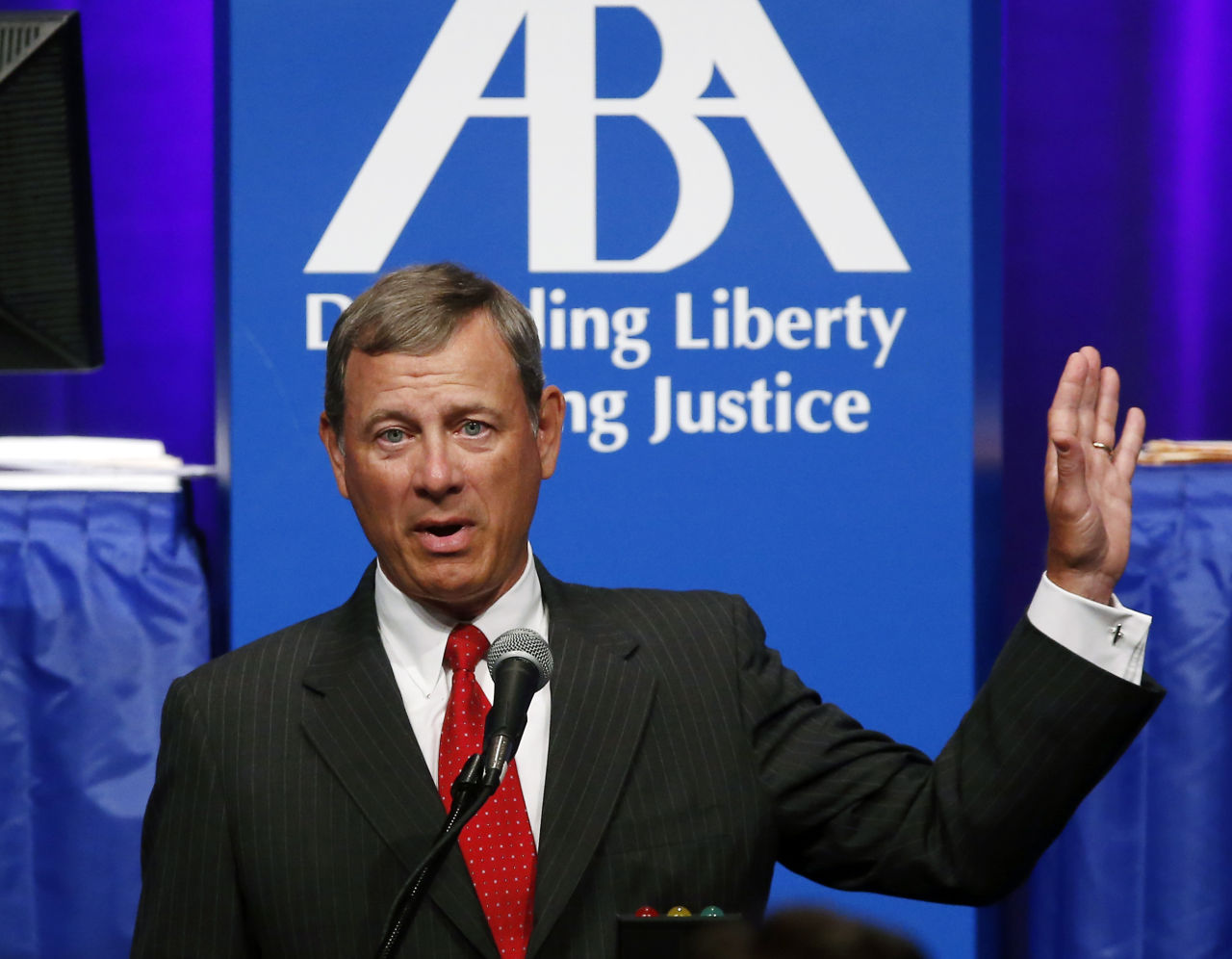 Supreme Court Chief Justice John Roberts speaks at the American Bar Association's annual meeting in Boston on Monday. (Elise Amendola/AP)