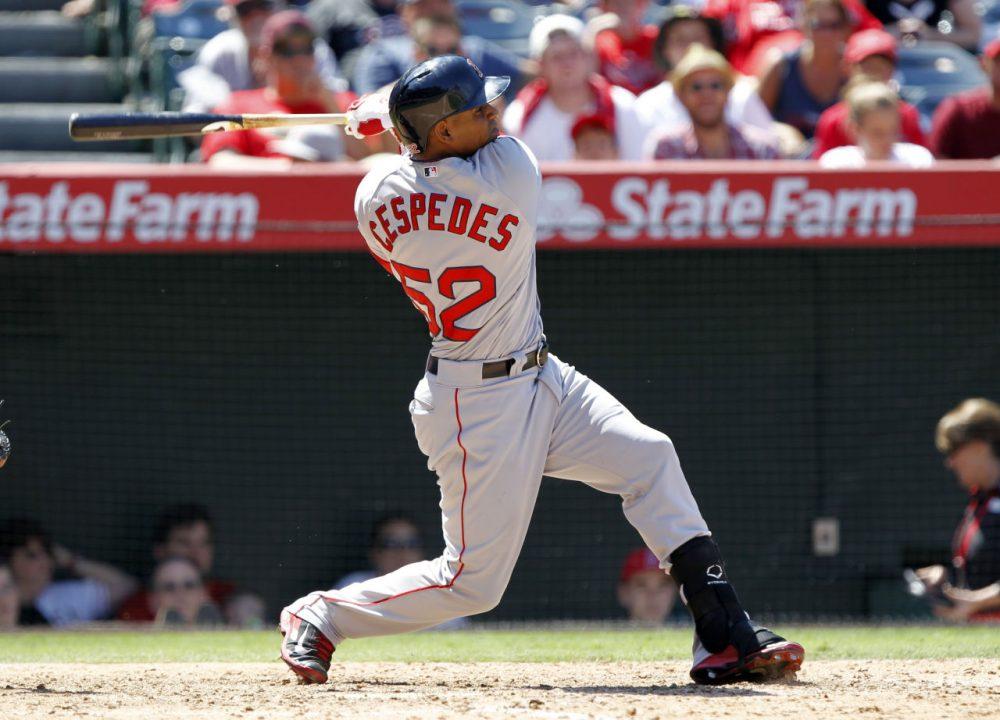 Yoenis Cespedes hits a three-run home run against the Los Angeles Angels. (Alex Gallardo/AP)
