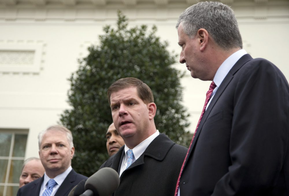 Boston Mayor Walsh speaks as Seattle Mayor Ed Murray and New York Mayor Bill de Blasio join him to speak to the media outside the West Wing of the White House. (Carolyn Kaster/AP)