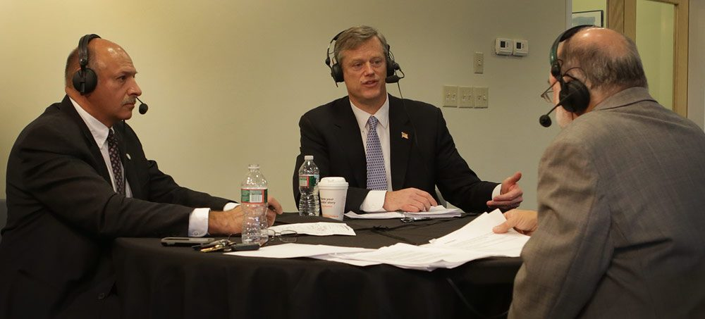 Republican gubernatorial candidates Mark Fisher, left, and Charlie Baker debate at WBUR Wednesday morning. WBUR host Bob Oakes moderates. (Robin Lubbock/WBUR)