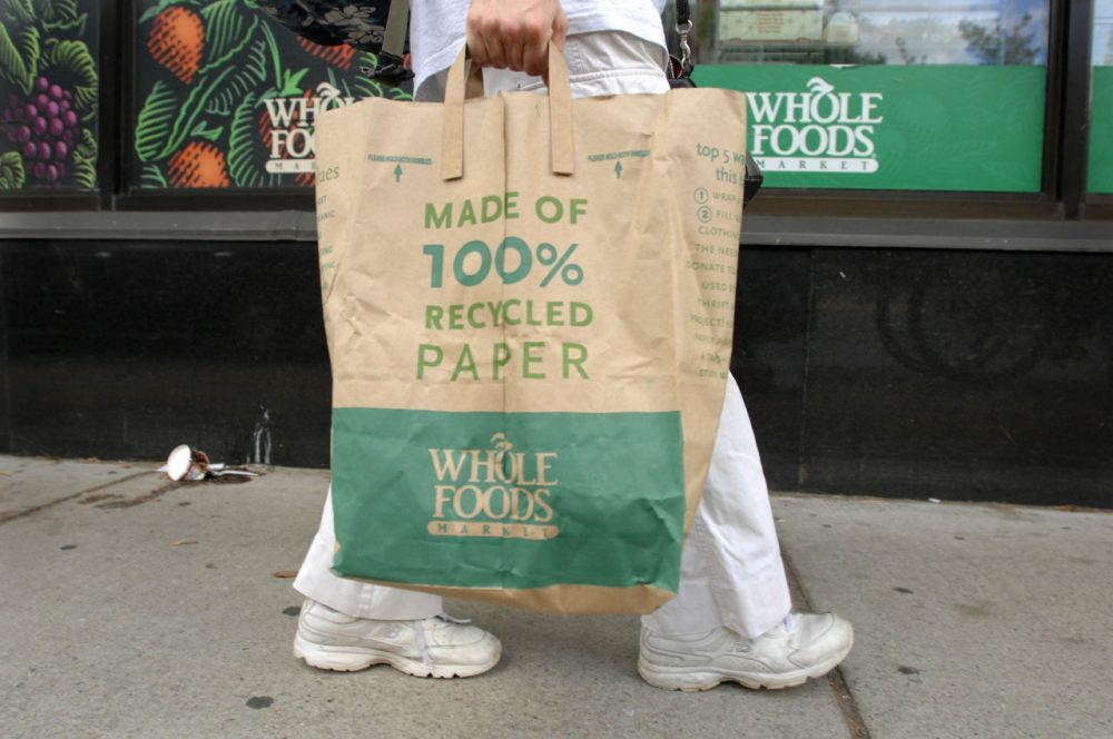 A customer walks home from the Whole Foods Market in Cambridge, Mass. in 2008 around the time of another beef recall due to E. coli bacteria. (Josh Reynolds/AP)