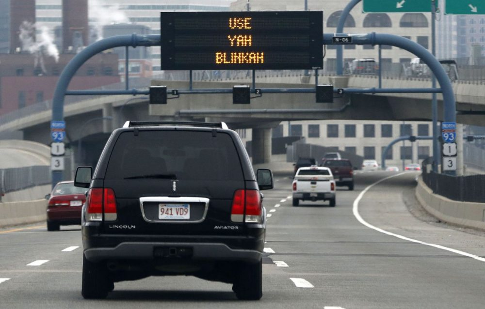 An electronic highway sign is seen on Interstate 93 in Boston last May. (Michael Dwyer/AP)