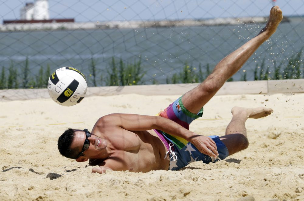 Todd Roark of Detroit dives during the beach volleyball competition at the Gay Games in Cleveland. (Mark Duncan/AP)