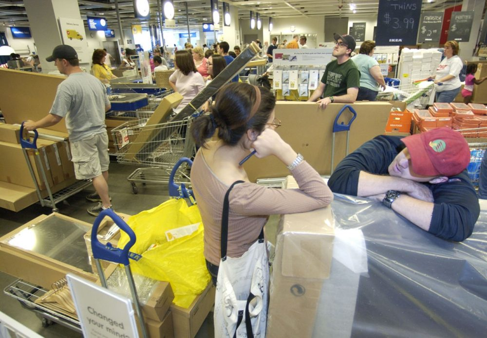 Sharon Squillace, center, and Glen Daly, right, both from Boston, wait in line after shopping tax free at IKEA in Stoughton, Mass. in 2007. (Lisa Poole/AP)