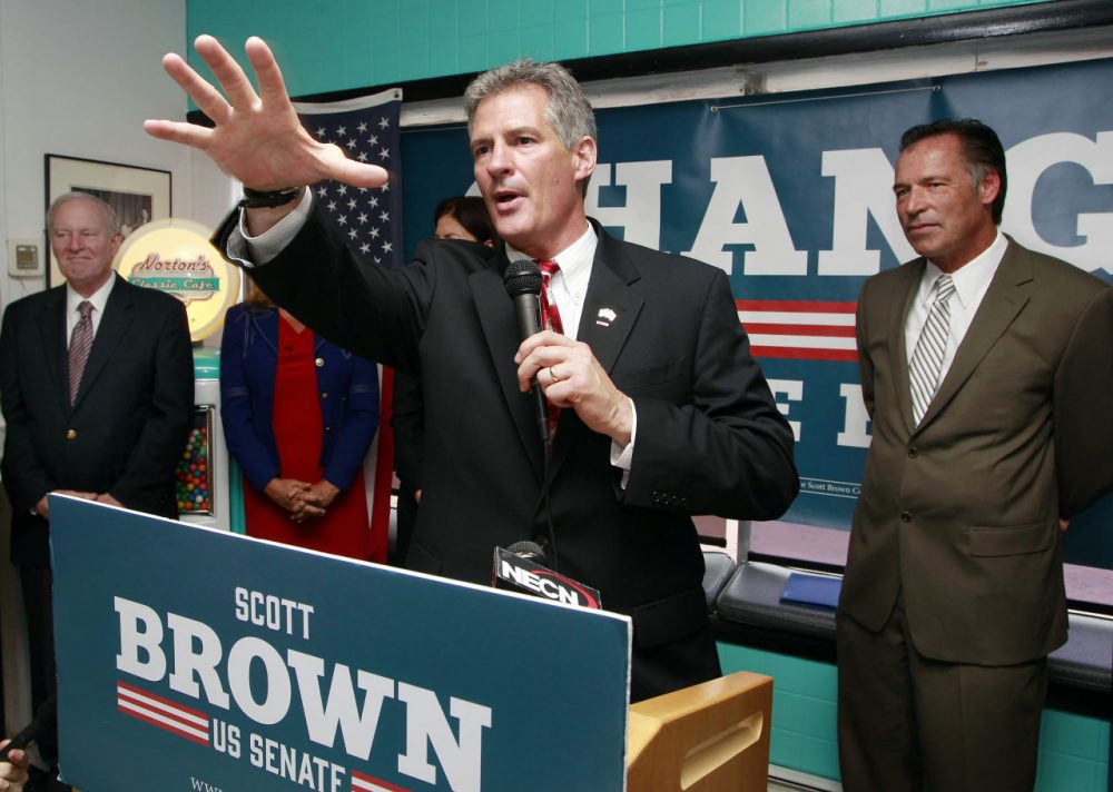 Former Mass. Senator and current Republican U.S. Senate candidate for N.H., Scott Brown, speaks on the campaign trail in August. (Jim Cole/AP)