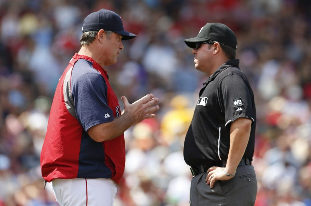 Boston Red Sox manager John Farrell, left, talks with first base umpire Doug Eddings as a play at second base is reviewed during the second inning.  (Michael Dwyer/AP)