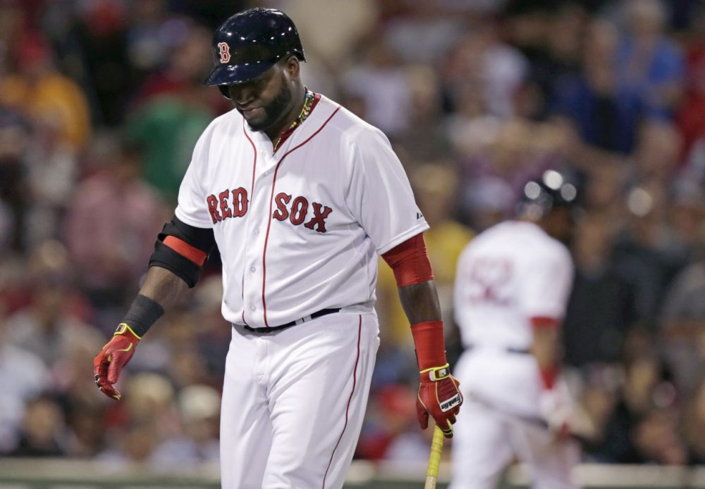 Boston Red Sox designated hitter David Ortiz heads to the dugout after striking out with two on during the ninth inning. (Charles Krupa/AP)