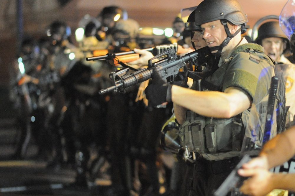 The protests in Ferguson brought attention to police departments with military weapons. Less known are educational institutions which received military weapons through the same Department of Defense program. (Michael B. Thomas/AFP/Getty Images)
