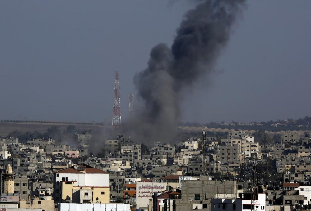 Smoke rises after an Israeli strike hits Gaza City in the northern Gaza Strip on Tuesday. (Adel Hana/AP)