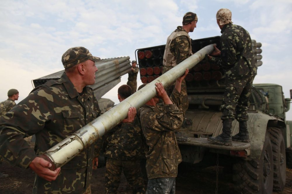 Ukrainian soldiers load a Grad missile during fighting with pro-Russian separatists close to Luhansk, eastern Ukraine, on Monday. (Petro Zadorozhnyy/AP)