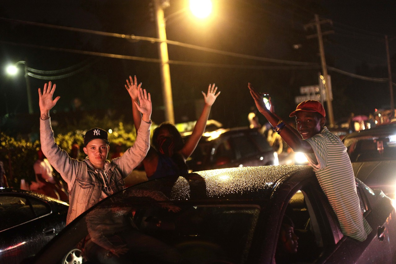 Demonstrators raise their hands as they protest the shooting death of 18-year-old Michael Brown on August 15, 2014 in Ferguson, Missouri. Michael Brown was killed in broad daylight on August 9. (Joshua LOTT/AFP/Getty Images)