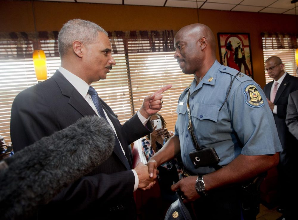 Attorney General Eric Holder talks with Capt. Ron Johnson of the Missouri State Highway Patrol at Drake's Place Restaurant Wednesday in Missouri. (Pablo Martinez Monsivais/AP/Pool)