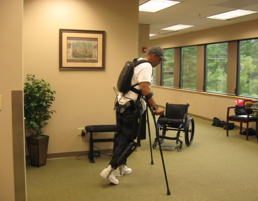 Gene Laureano, a 51-year-old Army veteran from the Bronx, uses the ReWalk exoskeleton. (WBUR/Sacha Pfeiffer)
