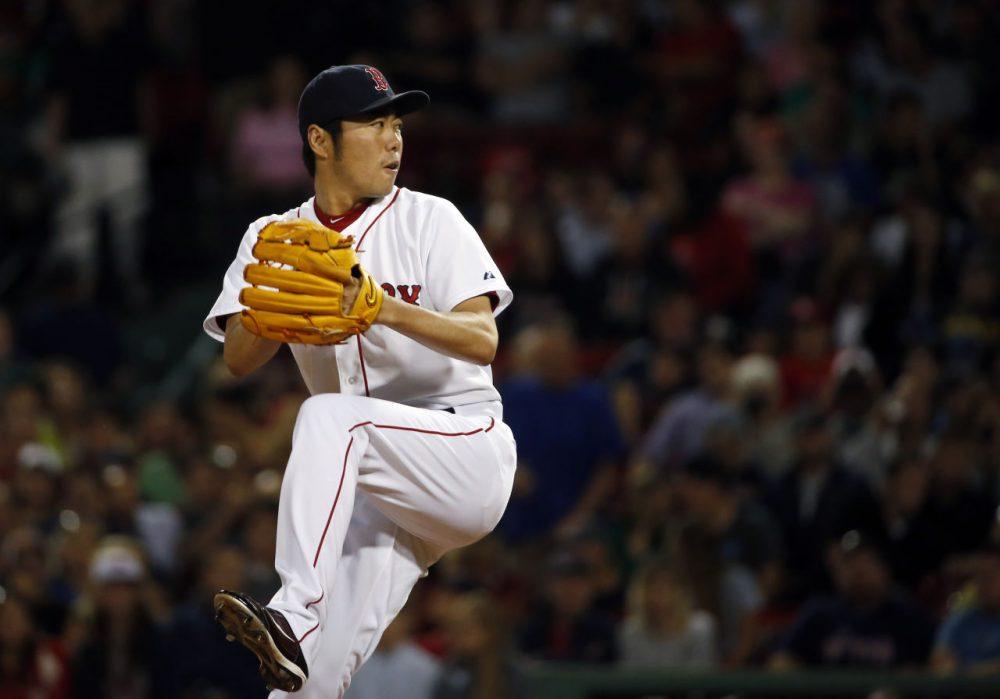 Boston Red Sox relief pitcher Koji Uehara pitches. (AP/Elise Amendola)