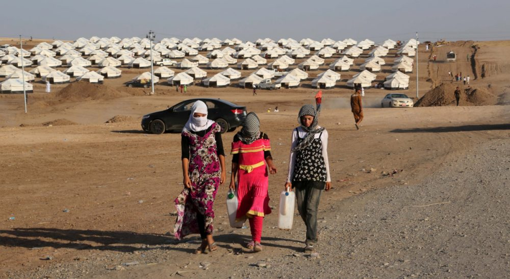Do we care about some conflicts more than others? Pictured: Displaced Iraqis from the Yazidi community settle at a new camp outside the old camp of Bajid Kandala at Feeshkhabour town near the Syria-Iraq border, Iraq, Friday, Aug. 15, 2014. (Khalid Mohammed/AP)