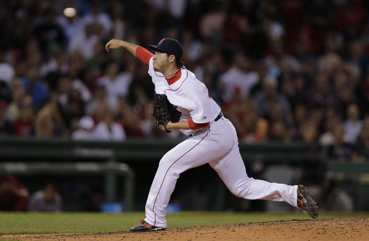 Boston Red Sox relief pitcher Junichi Tazawa (36) delivers during the eighth inning of a baseball game at Fenway Park in Boston on Thursday. (Charles Krupa/AP)
