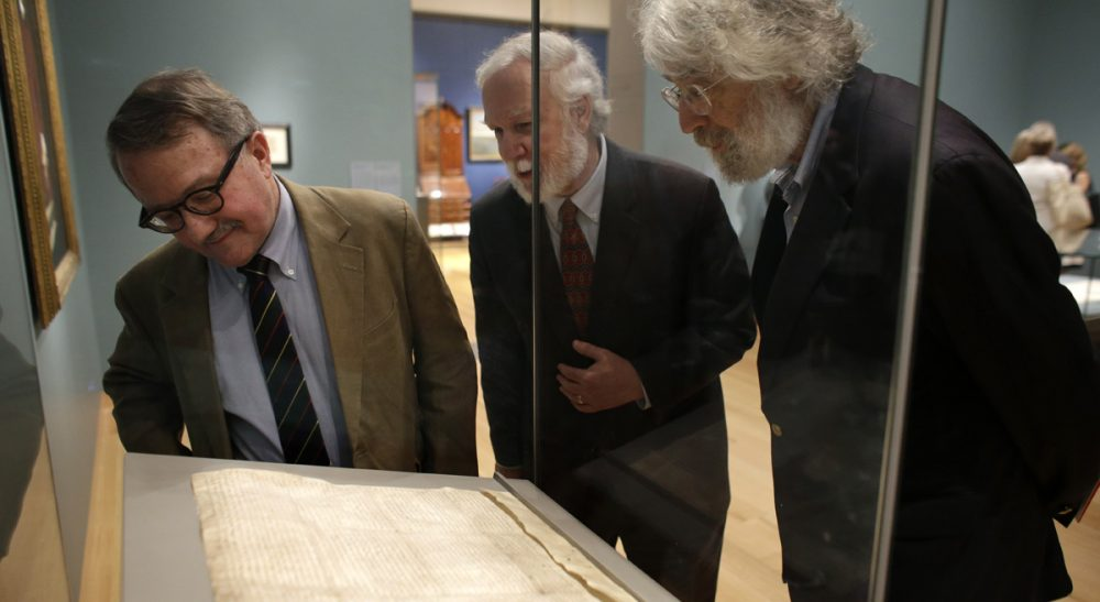 The Magna Carta is a foundational document of democracy. But it's also a reminder that power and wealth go hand in hand.  Pictured: Peter Drummey, of the Massachusetts Historical Society, left, Exhibition Curator and New Hampshire State Rep. Gerald Ward, D-Portsmouth, center, and Lloyd Schwartz, of Somerville, Mass., right, look at a copy of the Magna Carta in a display case at Boston's Museum of Fine Arts, Monday, June 30, 2014. (Steven Senne/AP)
