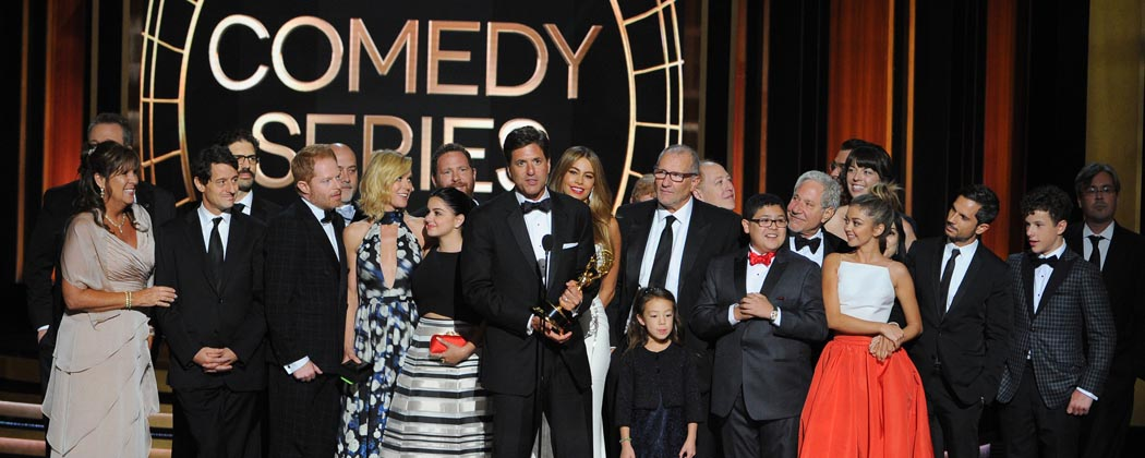 """Steven Levitan, center, and the producers and cast of """"Modern Family"""" accept the award for outstanding comedy series. (Vince Bucci/Invision/AP)"""