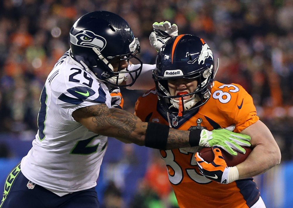 Wes Welker wore a bigger helmet during Super Bowl XLVIII against the Seahawks after suffering a two concussions in 22 days. Now, after yet another concussion in the preseason, some are wondering if he should consider retirement. (Jeff Gross/Getty Images)