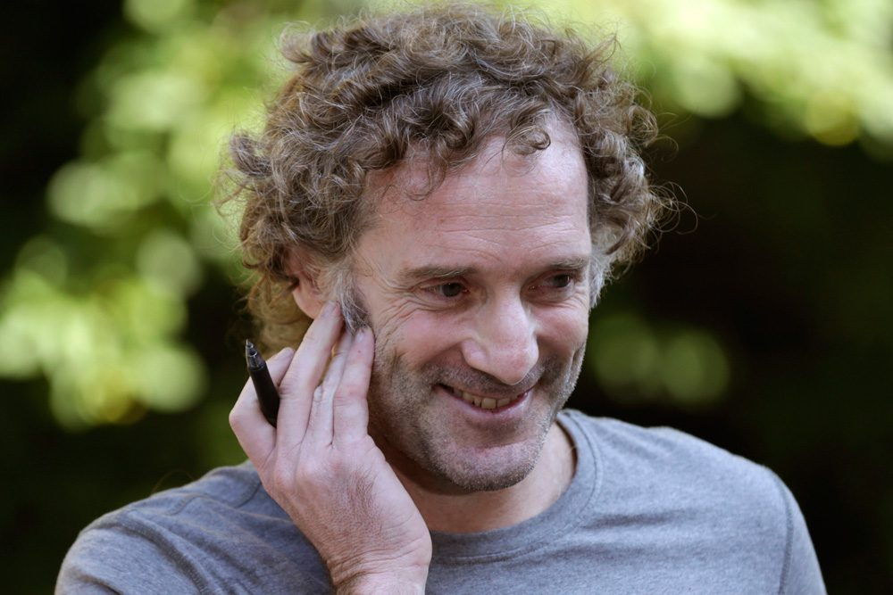 Peter Theo Curtis smiles as he talks with reporters outside his mother's home in Cambridge Wednesday. Curtis, a freelance reporter who wrote under the byline Theo Padno and who had been held hostage for about two years in Syria, returned to the U.S. Tuesday. (Charles Krupa/AP)