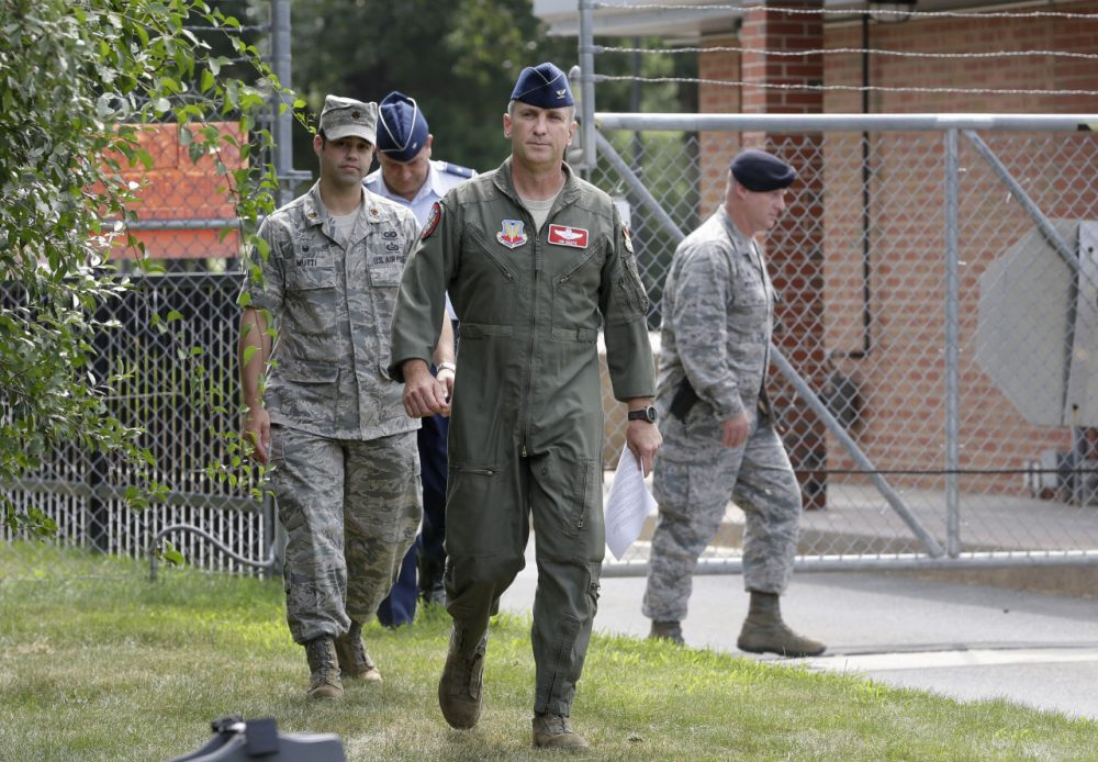 U.S. Air National Guard Col. James Keefe, commander of the 104th Fighter Wing, center, approaches members of the media outside the main gate of Barnes Air National Guard Base, in Westfield, Mass. to discuss the jet crash. (Steven Senne/AP)