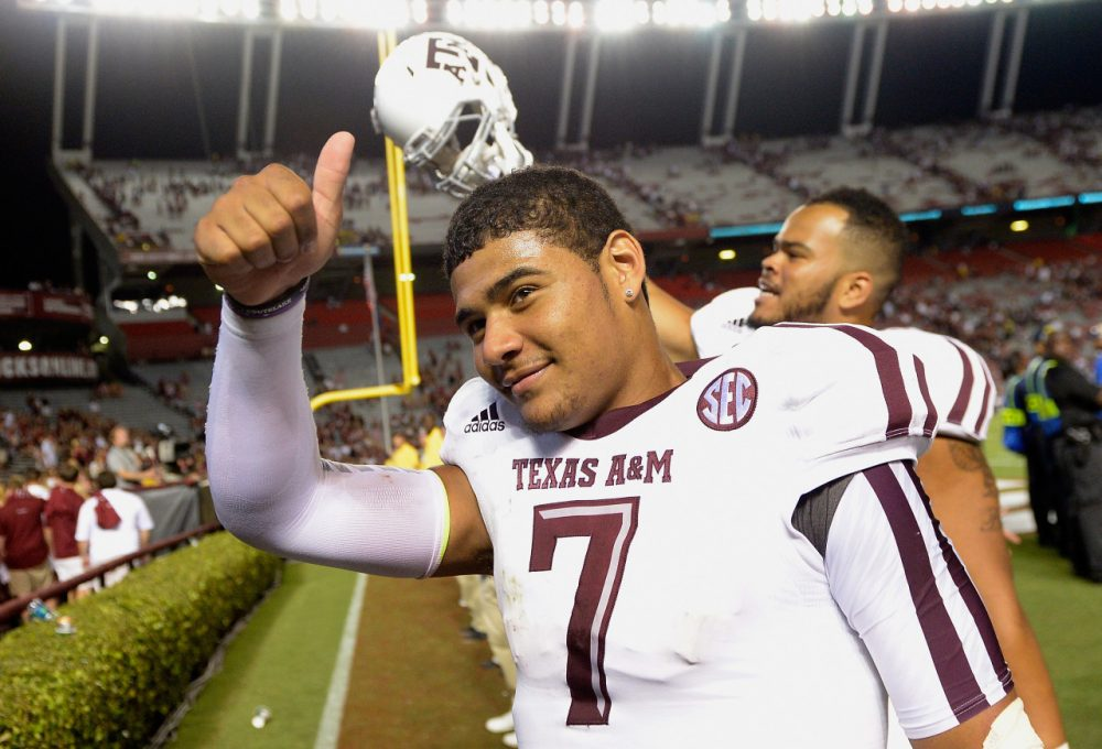 Texas A&M quarterback Kenny Hill flashes a thumbs up after breaking Johnny Manziel's single-game passing record. (Grant Halverson/Getty Images)