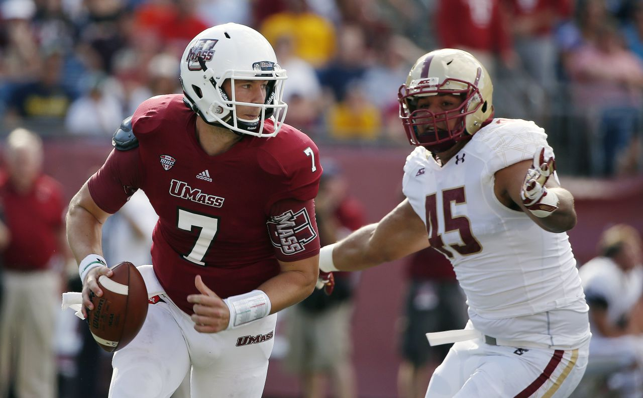 Massachusetts Blake Frohnapfel and Boston College defensive lineman Mehdi Abdesmad during the first half of the game. (Michael Dwyer/AP)