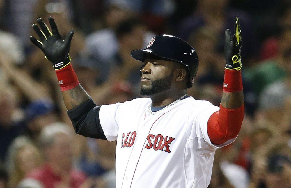 Red Sox's David Ortiz celebrates his two-run home run during the third inning  Saturday. (Michael Dwyer/AP)