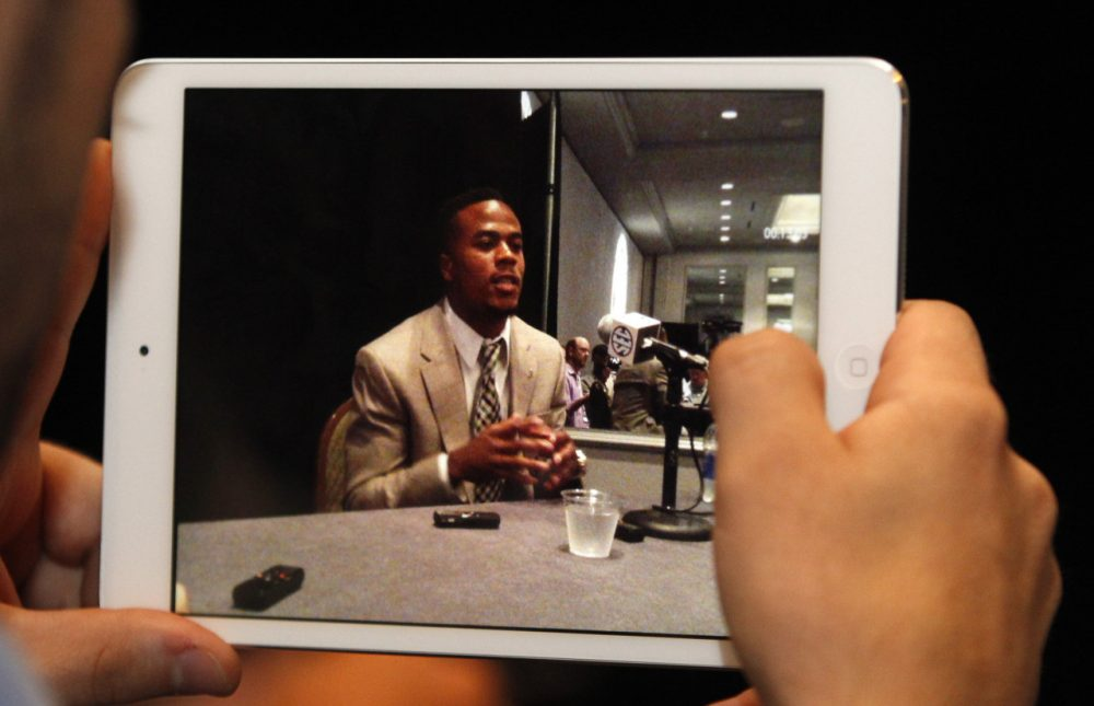 A reporter films Alabama wide receiver Christion Jones on his IPad as he speaks to media at the Southeastern Conference NCAA college football media days on Thursday, July 17, 2014, in Hoover, Ala. (AP)