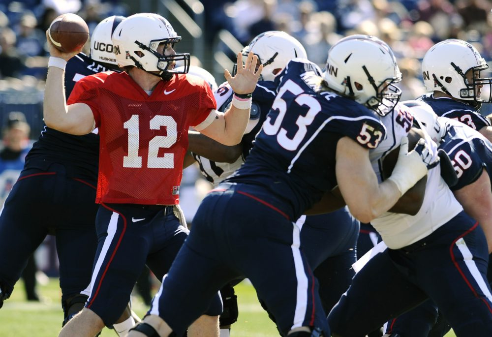 during the first half of UConn's Blue-White spring NCAA college football game at Rentschler Field, Saturday, April 12, 2014, in East Hartford, Conn. (AP)
