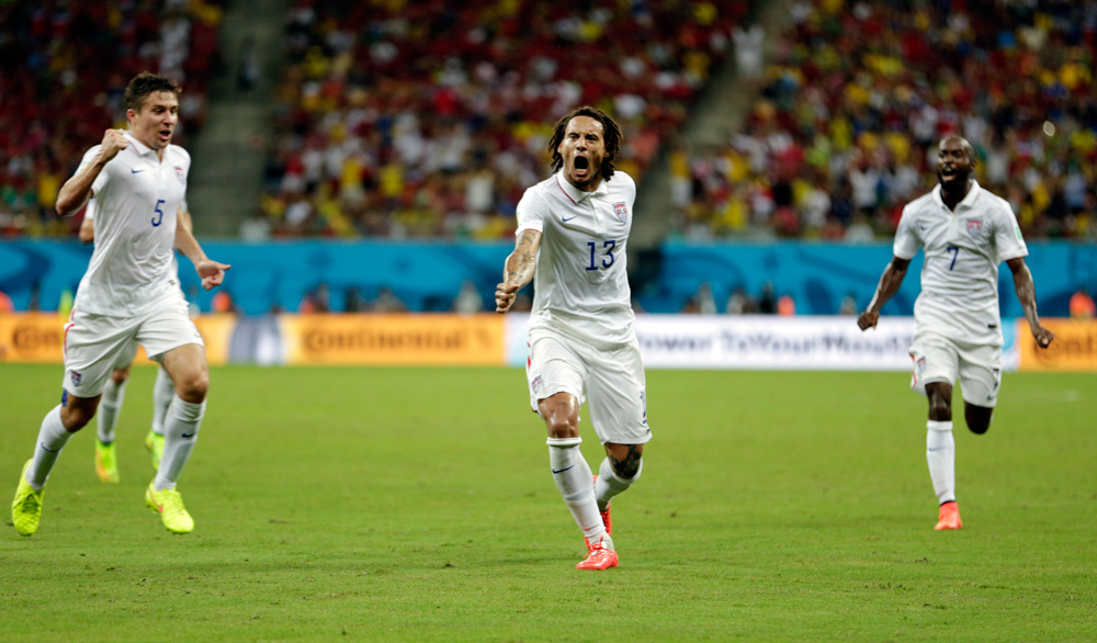 U.S. midfielder Jermaine Jones (13) celebrates after scoring his side's first goal during a World Cup match against Portugal in Brazil on June 22. (Julio Cortez/AP)